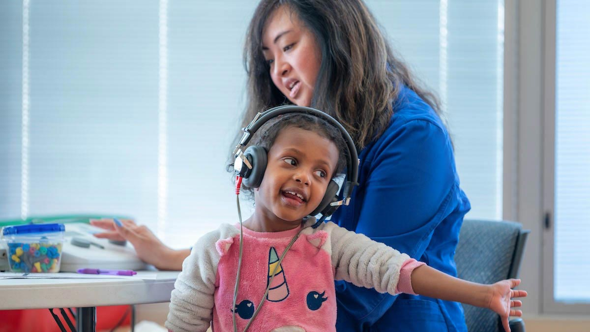 woman and a child with a headset