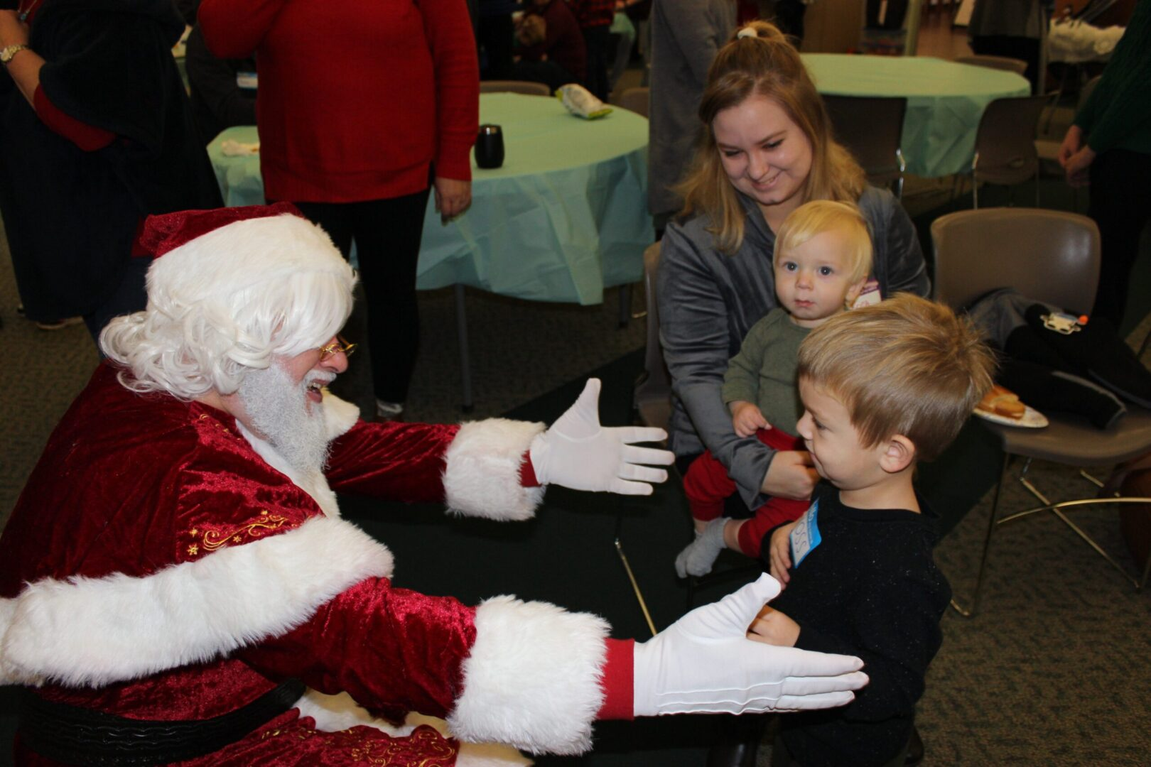 Santa Claus and little kids