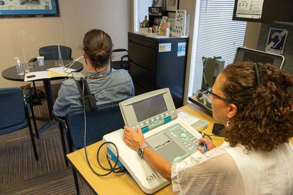 Dr. Gabbard tests Nathan's hearing.